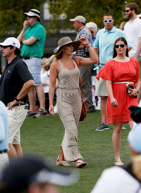 . Skier Lindsey Vonn (C), girlfriend of Tiger Woods, watches play with physical therapist Lindsay Winninger (R) during first round play in the 2013 Masters golf tournament at the Augusta National Golf Club in Augusta, Georgia, April 11, 2013.      REUTERS/Mike Segar