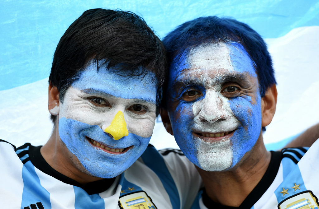 . Argentina fans enjoy the atmosphere prior to the 2014 FIFA World Cup Brazil Semi Final match between the Netherlands and Argentina at Arena de Sao Paulo on July 9, 2014 in Sao Paulo, Brazil.  (Photo by Matthias Hangst/Getty Images)