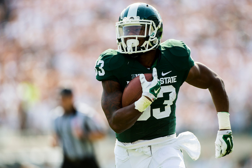 . Michigan State running back Jeremy Langford  runs the ball into the end zone for a touchdown during the first half on Saturday, Sept. 20, 2014 at Spartan Stadium in East Lansing, Mich. (AP Photo/The Flint Journal, Jake May)
