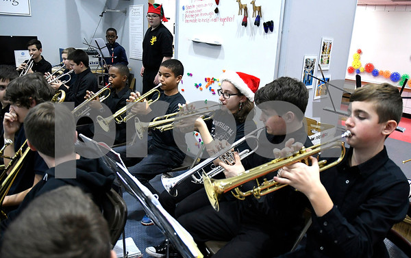 12/21/2017 Mike Orazzi   Staff Members of the Northeast Middle School Tigers Wind Ensemble perform during a Christmas concert at theImagine Nation, A Museum Early Learning Center Thursday afternoon.