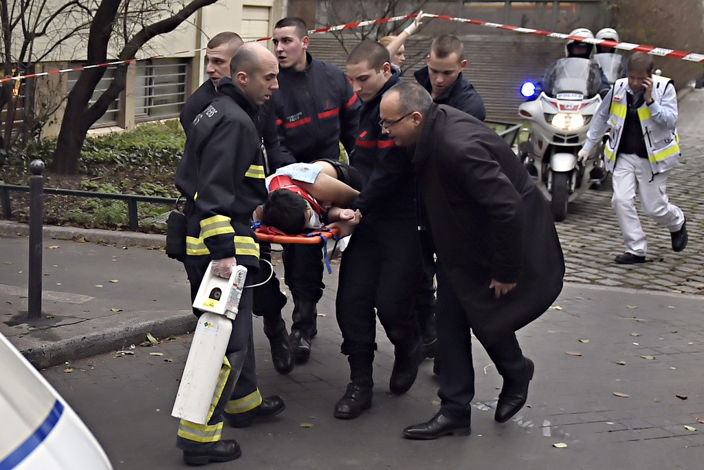 . A victim is evacuated on a stretcher on January 7, 2015 after armed gunmen stormed the offices of the French satirical newspaper Charlie Hebdo in Paris, leaving at least 11 people dead.  AFP PHOTO / MARTIN  BUREAU/AFP/Getty Images