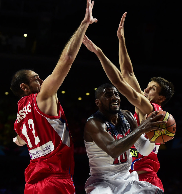 . US guard Kyrie Irving (C) vies with Serbia\'s centre Nenad Krstic (L) and Serbia\'s forward Stefan Bircevic during the 2014 FIBA World basketball championships final match USA vs Serbia at the Palacio de los Deportes in Madrid on September 14, 2014.   JAVIER SORIANO/AFP/Getty Images