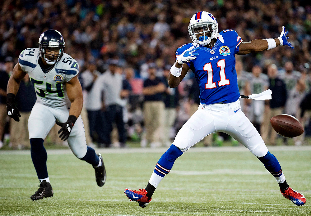 . Buffalo Bills wide receiver T.J. Graham (11) drops the ball as Seattle Seahawks linebacker Bobby Wagner (54) watches during the first half of an NFL football game, Sunday, Dec. 16, 2012, in Toronto. (AP Photo/The Canadian Press, Nathan Denette)