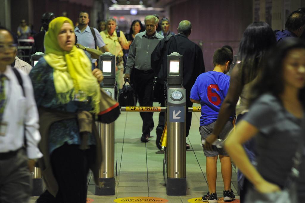. Subway passengers pass through the turnstiles at the Union Station metro subway, Tuesday, June 18, 2013. (Michael Owen Baker/Staff Photographer)