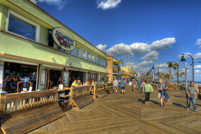 People enjoy a warm winter day on the Boardwalk in Myrtle Beach, South Carolina on Thursday, February 2, 2012. Copyright 2012 Jason Barnette