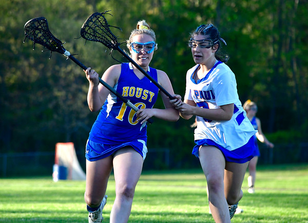 5/8/2019 Mike Orazzi | Staff Housatonic Regional's Madison Simonds (16) and St. Paul's Madeline Fisher (9) during Wednesday's girls lacrosse in Bristol.