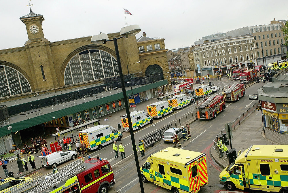 Description of . Emergency services are seen outside the main line station at Kings Cross following an explosion which has ripped through London's tube network on July 7, 2005 in London, England. Blasts have been reported on the underground network and double decker buses in the capital. (Photo by Dean Mouhtaropoulos/Getty Images)
