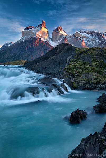 Sunrise over the Salto Grande cascades, with the Cuernos del Paine mountains - in Torres del Paine national park, Chile.