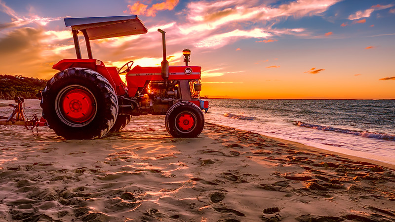 0518L-Sun sets on the beach tractor-PRyan.jpg