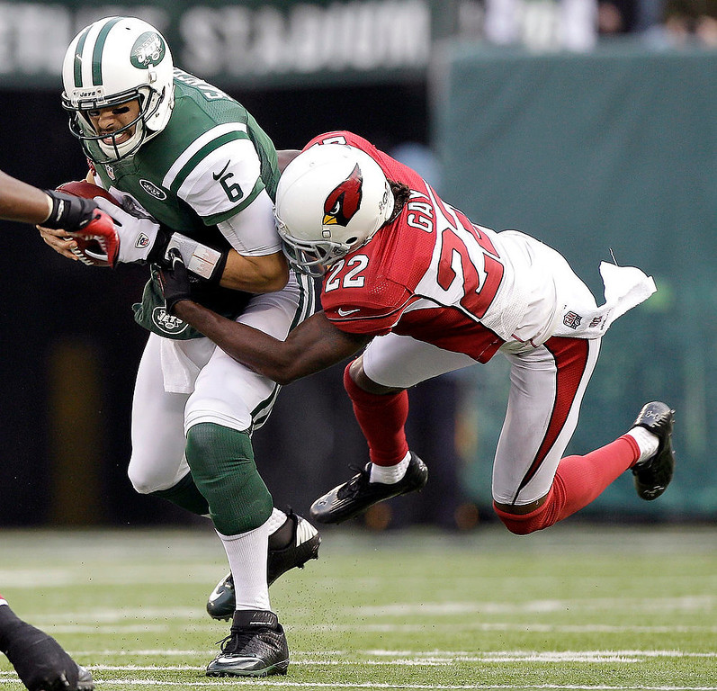 . New York Jets quarterback Mark Sanchez (6) is sacked by Arizona Cardinals cornerback William Gay (22) during the second half of an NFL football game, Sunday, Dec. 2, 2012, in East Rutherford, N.J. (AP Photo/Kathy Willens)