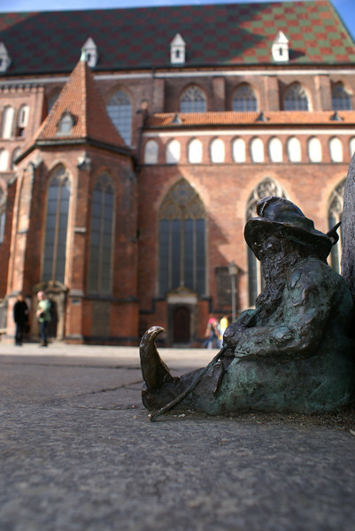 """In Wroclaw there are dozens of tiny dwarf sculptures all over the city. Seeking them out is a tourist pastime. As the story goes, in the 80s a communist opposition group had the symbol of a small dwarf. The opposition group leader once said, """"How can you take the police seriously when they ask you if you've been participating in an illegal meeting of dwarves?"""" So today, the city remembers the opposition with the little statues."""
