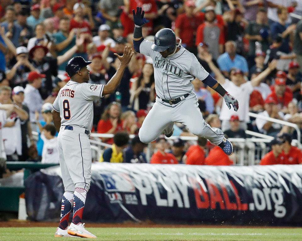 . Seattle Mariners shortstop Jean Segura (2) celebrates his three-run homer in the eighth inning during the Major League Baseball All-star Game, Tuesday, July 17, 2018 in Washington. (AP Photo/Alex Brandon)