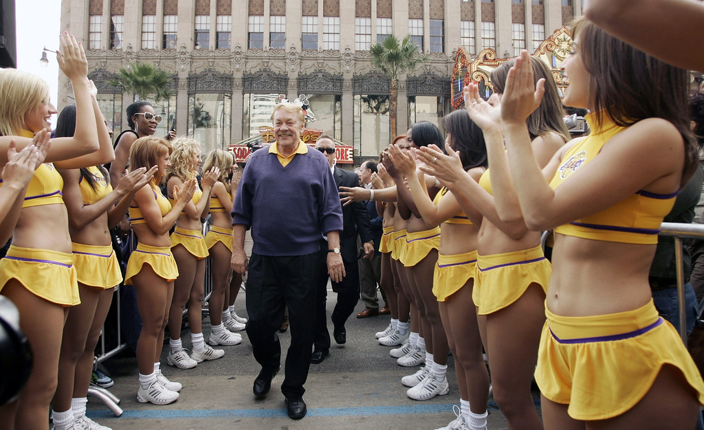 . Jerry Buss, center, owner of the Los Angeles Lakers, is greeted by the Lakers Girls cheerleaders, after being honored with a television star on the Hollywood Walk of Fame in the Hollywood section of Los Angeles, Monday, Oct. 30, 2006. (AP Photo/Damian Dovarganes)