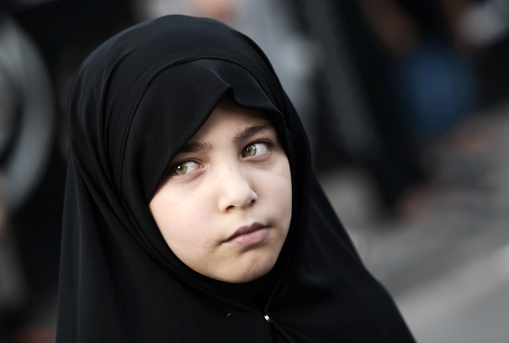 . A Bahraini Shiite Muslim girl takes part in a ceremony marking Ashura, which commemorates the seventh century slaying of Imam Hussein, the grandson of Prophet Mohammed, in the village of Sanabis, west of Manama on November 1, 2014. MOHAMMED AL-SHAIKH/AFP/Getty Images