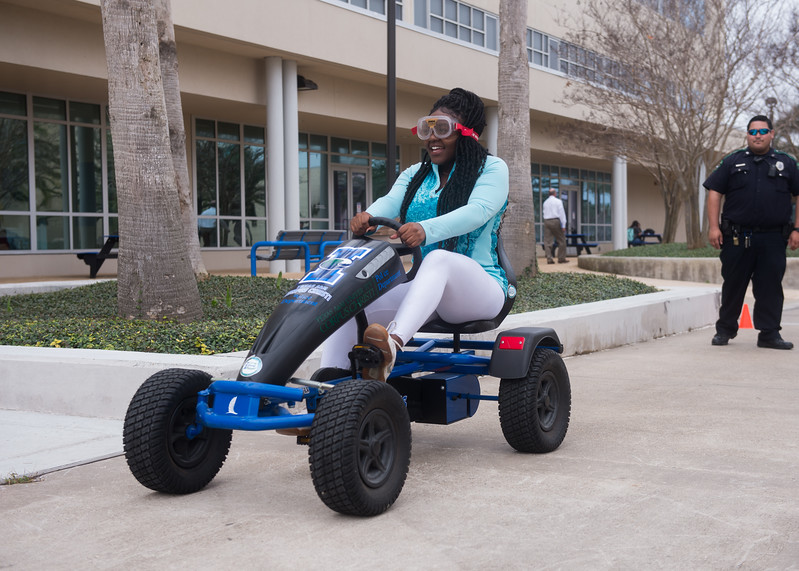 Student Quiniah Lee goes through the Drunk Goggles obstacle course.