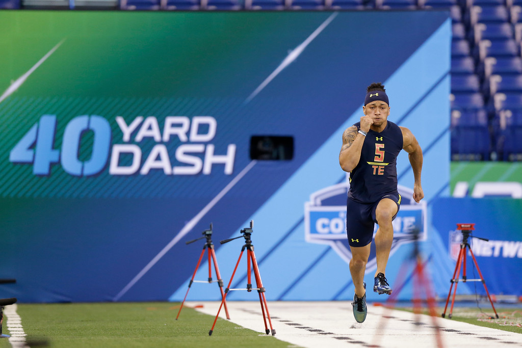 . Mississippi tight end Evan Engram runs the 40-yard dash at the NFL football scouting combine in Indianapolis, Saturday, March 4, 2017. (AP Photo/Michael Conroy)