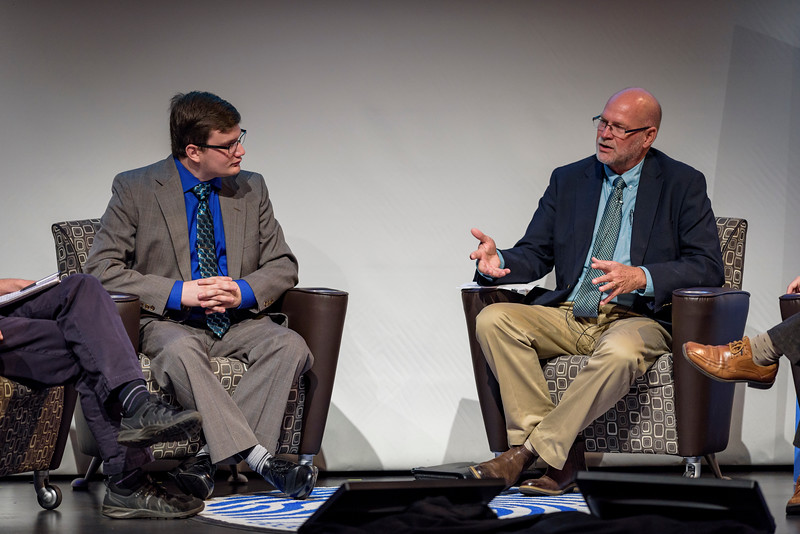 Brad Pushkar, editor-in-chief of the Purdue Exponent, and Kip Williams, Distinguished Professor of Social Psychology, speak on a panel during the second day of the Dawn Or Doom conference in Fowler Hall. (Purdue University Photo/Alex Kumar)