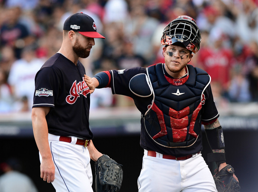 . Cleveland Indians catcher Roberto Perez, right, pats pitcher Corey Kluber during the third inning against the Boston Red Sox in Game 2 of a baseball American League Division Series, Friday, Oct. 7, 2016, in Cleveland. (AP Photo/Aaron Josefczyk)