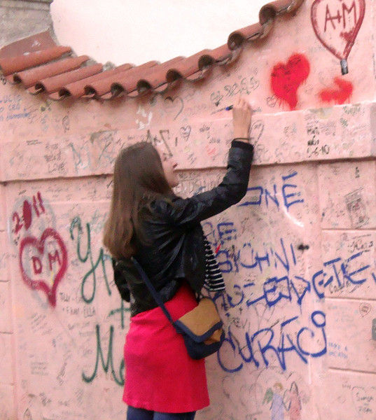 Lovers write their prayers and initials on this famous wall...