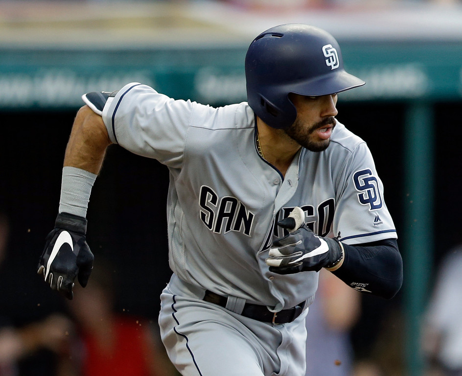 . San Diego Padres\' Carlos Asuaje runs out an RBI-single in the fourth inning of a baseball game against the Cleveland Indians, Wednesday, July 5, 2017, in Cleveland. Asuaje tried to stretch a single into a double and was tagged out at second base. (AP Photo/Tony Dejak)