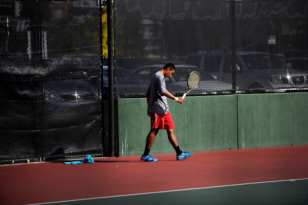 . DENVER, CO. - OCT 12:   Ignatius Castelino, of Fairview, walks across court during his #1 singles match against Cherry Creek\'s Zach Fryer. Fryer won the match held during the final day of the 5A Boys\' Tennis Championships at Gates Tennis Center on Oct. 12, 2013.  (Photo By Erin Hull/The Denver Post)