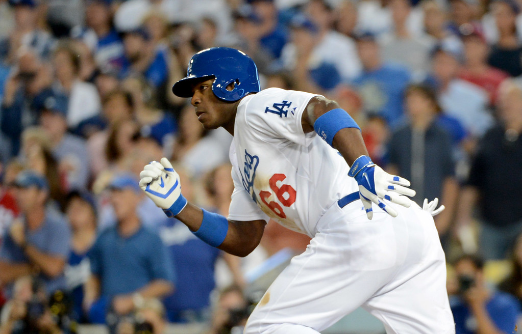 . Los Angeles Dodgers\' Yasiel Puig hits a single bringing in Adrian Gonzalez in the fourth inning during the NLCS at Dodger Stadium against the St. Louis Cardinals Tuesday, October 15, 2013. (Photo by David Crane/Los Angeles Daily News)