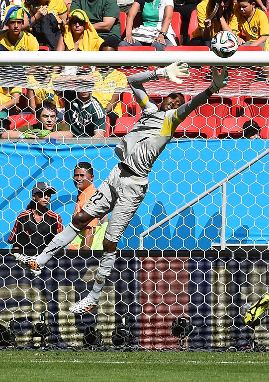 . Ecuador\'s goalkeeper Alexander Dominguez jumps to save a goal during a Group E football match between Switzerland and Ecuador at the Mane Garrincha National Stadium in Brasilia during the 2014 FIFA World Cup on June 15, 2014.    AFP PHOTO/ ANNE-CHRISTINE POUJOULAT