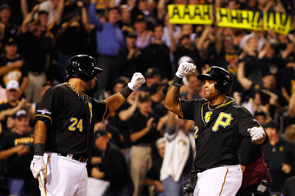 . PITTSBURGH, PA - OCTOBER 01:  Marlon Byrd #2 celebrates his second inning home run with Pedro Alvarez #24 of the Pittsburgh Pirates during their National League Wild Card game against the Cincinnati Reds at PNC Park on October 1, 2013 in Pittsburgh, Pennsylvania.  (Photo by Justin K. Aller/Getty Images)