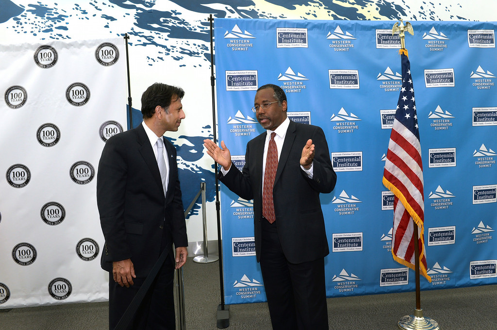 . DENVER, CO - JULY 18: Louisiana Gov. Bobby Jindal and Dr. Ben Carson chatted as they waited to pose for photos with supporters as the Western Conservative Summit kicked off Friday night, July 18, 2014 in Denver. The weekend gathering of conservative voters heard remarks from Jindal, Utah Senator Mike Lee and Dr. Ben Carson Friday night. Photo by Karl Gehring/The Denver Post