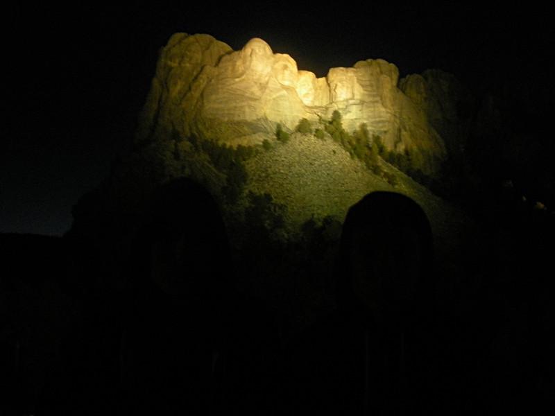 Mount Rushmore at night.
