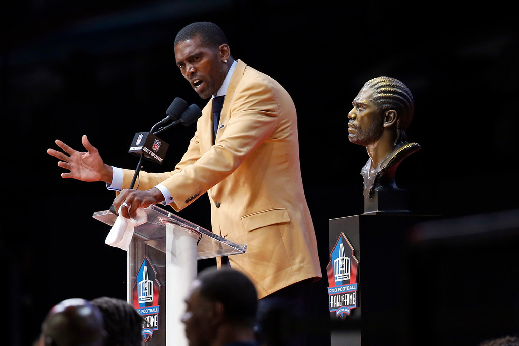 . Former NFL player Randy Moss gives a speech during an induction ceremony at the Pro Football Hall of Fame, Saturday, Aug. 4, 2018, in Canton, Ohio. (AP Photo/Ron Schwane)