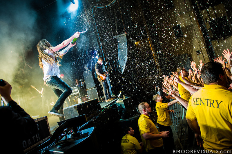 Spencer Chamberlain of Underoath showers the crowd with champagne during the last song of their final show on January 26, 2013 at Jannus Live in St. Petersburg, Florida