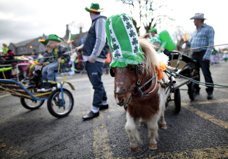 . Children ride on a pony during the St. Patrick\'s Day parade in Limerick, Ireland, Sunday, March 17, 2013.  (AP Photo/Peter Morrison)