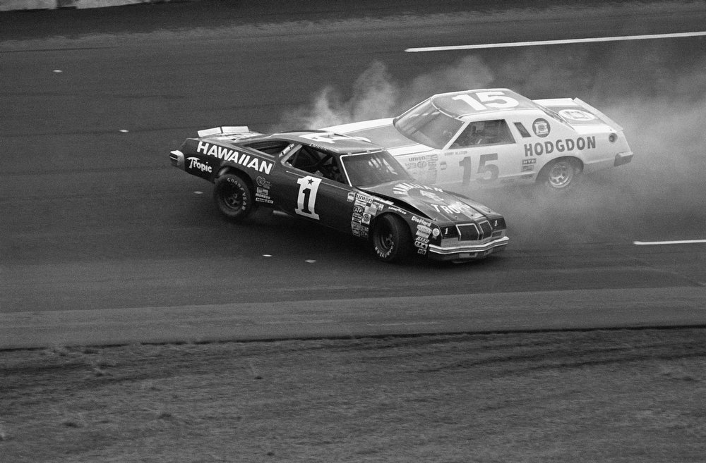 Description of . Donnie Allison (1)  gets by brother Bobbie (15) in the early stages of the Daytona 500 race at the Daytona International Speedway Sunday, February 18,1979 at Daytona Beach. (AP Photo)