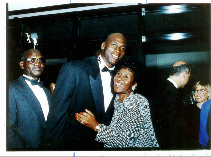 . Chicago Bulls\' Michael Jordan hugs his mother, Delores, in this Sept. 15, 1990 file photo as his father, James, looks on, during a gala dinner for the Michael Jordan Foundation at the Hotel Nikko in Chicago. Daniel Green was convicted of murder Thursday, Feb. 29, 1996, in Lumberton, N.C., for the 1993 shooting death of James Jordan. (AP Photo/Chicago Tribune, John Bartley, File)