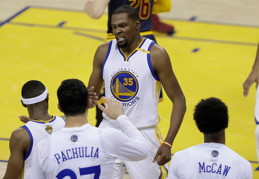 . Golden State Warriors forward Kevin Durant (35) celebrates with teammates during the first half of Game 1 of basketball\'s NBA Finals against the Cleveland Cavaliers in Oakland, Calif., Thursday, June 1, 2017. (AP Photo/Marcio Jose Sanchez)