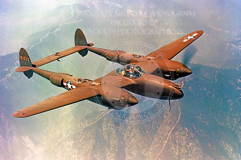 P-38 00024 A flying olive drab Lockheed P-38 Lightning, military airplane picture, Official USAF Photograph.JPG