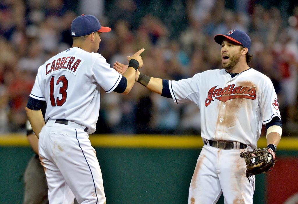 . Jeff Forman/JForman@News-Herald.com Asdrubal Cabrera and jason Kipnis celebrate the Indians\' 3-2 win over the Red Sox June 2 at Progressive Field.