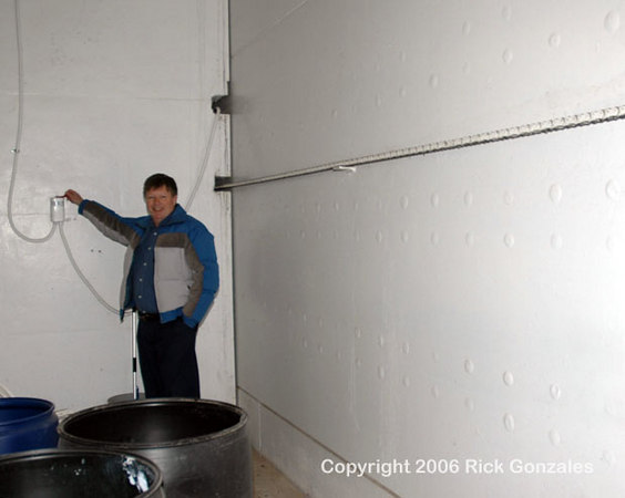 Missile facility owner, Don Zwonitzer, operates the now electric door control.