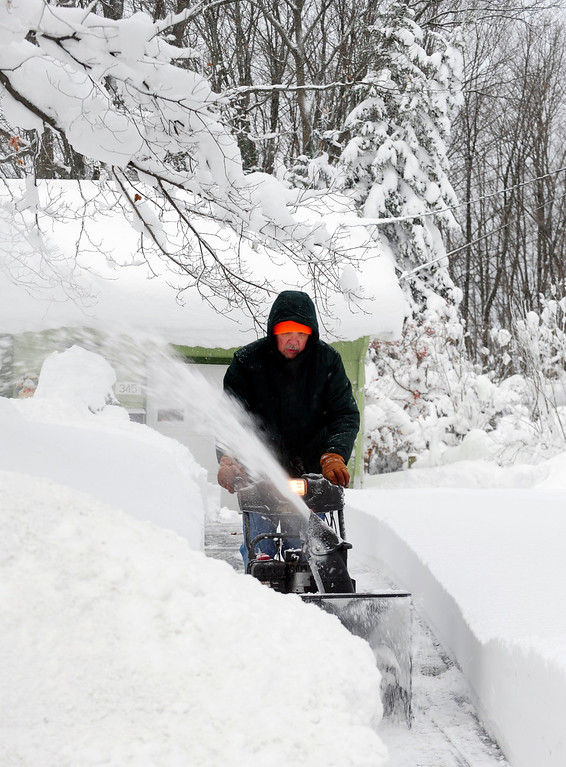 . Mike Jason cuts a path with his snowblower after another 15 inches fell last night in East Aurora, N.Y. Thursday, Nov. 20, 2014.  A new blast of lake-effect snow pounded Buffalo for a third day piling more misery on a city already buried by an epic, deadly snowfall that could leave some areas with nearly 8 feet of snow on the ground when it\'s all done.  (AP Photo/Gary Wiepert)