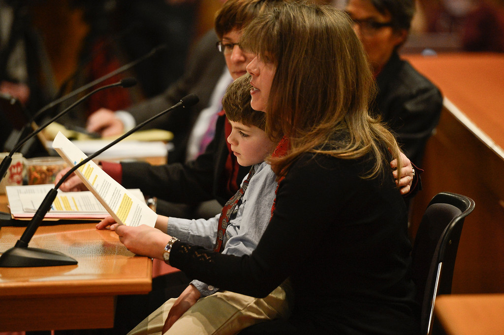 . Denver, CO. - January 23: Five year old Jeremy Simon sits on Anna\'s lap as he and his two moms Anna and Fran gave testimony to the Senate Judiciary Committee on Senate Bill 11 at the Denver State Capitol. The bill would allow gay couples to form civil unions.   Denver, Colorado January 23, 2013. (Photo By Joe Amon / The Denver Post)