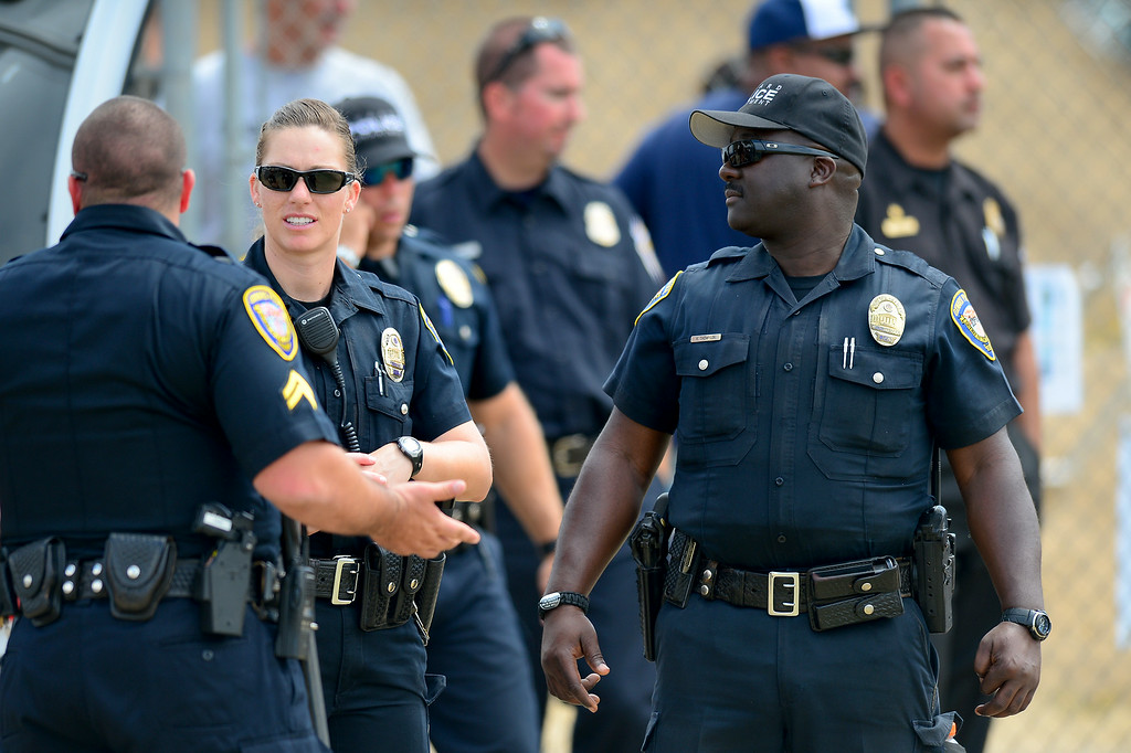 . Law enforcement turn out for the Cowboys-Raiders practice in Oxnard, Wednesday, August 13, 2014. (Photo by Michael Owen Baker/Los Angeles Daily News)