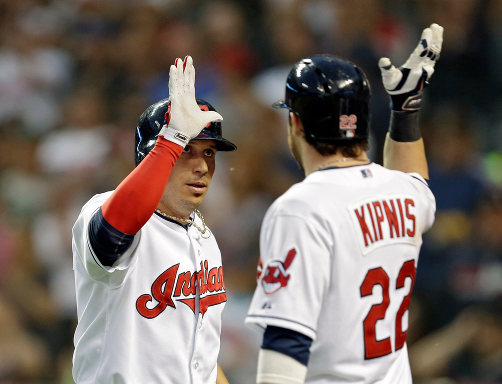 . Cleveland Indians\' Asdrubal Cabrera is congratulated by Jason Kipnis (22) after a two-run home run against the Colorado Rockies in the fifth inning of a baseball game Friday, May 30, 2014, in Cleveland. (AP Photo/Mark Duncan)