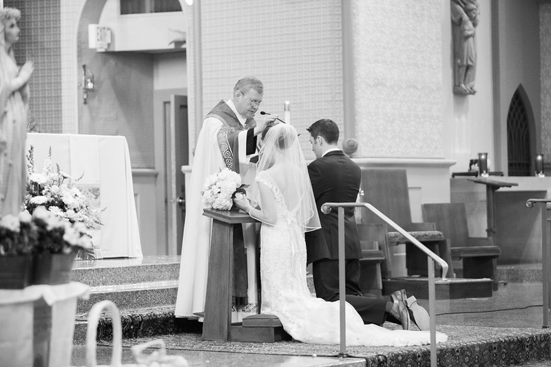 Catholic nuptial blessing during wedding mass. The Baltimore area Catholic wedding ceremony was at The Church of the Immaculate Conception in Towson, MD. This was a 1840s Plaza wedding reception. The best Baltimore wedding photographer was Jalapeno Photography.