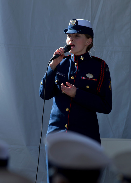 . Petty Officer FIrst Class Megan Weikleenget performs the national anthem during a memorial service for U.S. Coast Guard Boatswain\'s Mate Third Class Travis R. Obendorf, Thursday, Jan. 30, 2014 on Coast Guard Island in Alameda, Calif. Obendorf suffered fatal injuries while performing his duties aboard the Coast Guard Cutter Waesche as part of a search and rescue off the coast of the Alaska in November 2013. (D. Ross Cameron/Bay Area News Group)