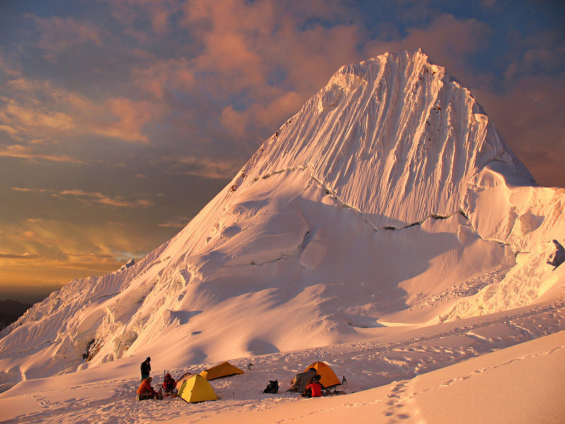 Sunset on the Southwest Face of Nevado Alpamayo (5947 meters) in the Cordillera Blanca of Peru.  Together with Catalan climbers Eloi Callado and Joan Sole, we made an ascent of the French route, the line up the central ice gully leading to the top of the peak. June 2009.