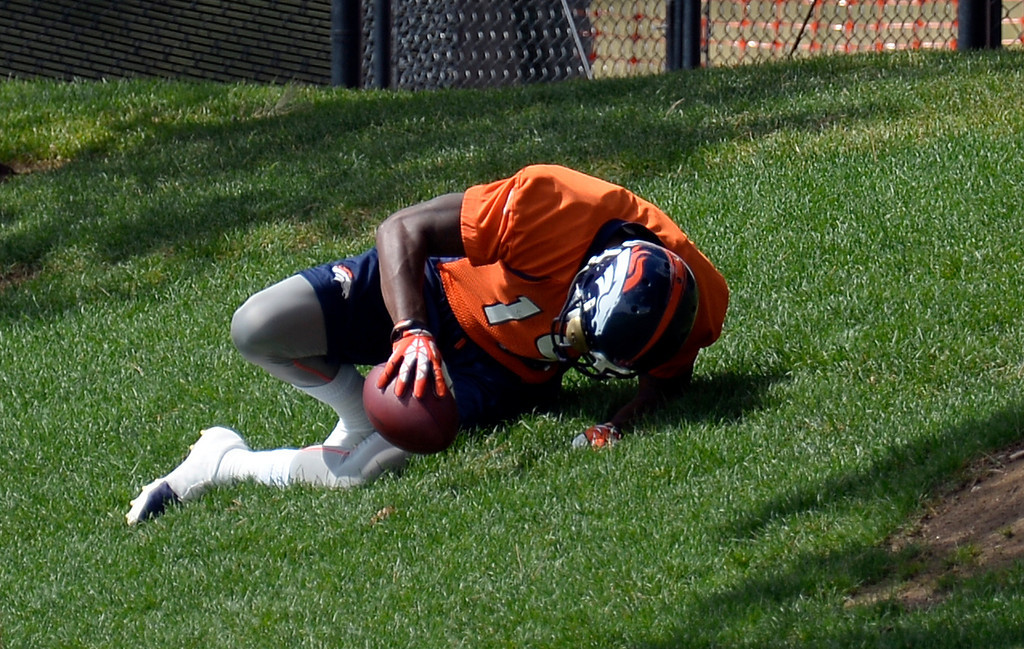 . Denver Broncos wide receiver Lamaar Thomas (19) lays on the grass in pain after going down with an injury after catching a pass during practice August 23, 2013 at Dove Valley (Photo by John Leyba/The Denver Post)