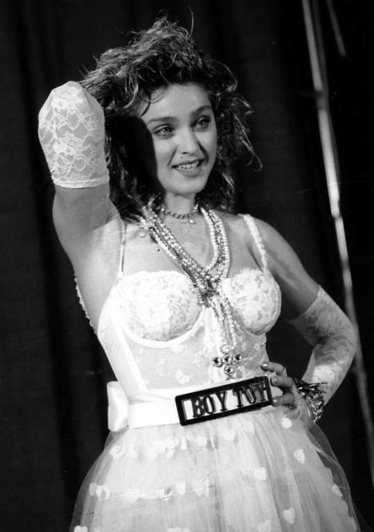 . Madonna poses at the MTV Video Music Awards, in this Sept. 14, 1984 file photo, in New York\'s Radio City Music Hall. On Aug. 1 MTV marks 25 years on the air.  (AP Photo/FILE)