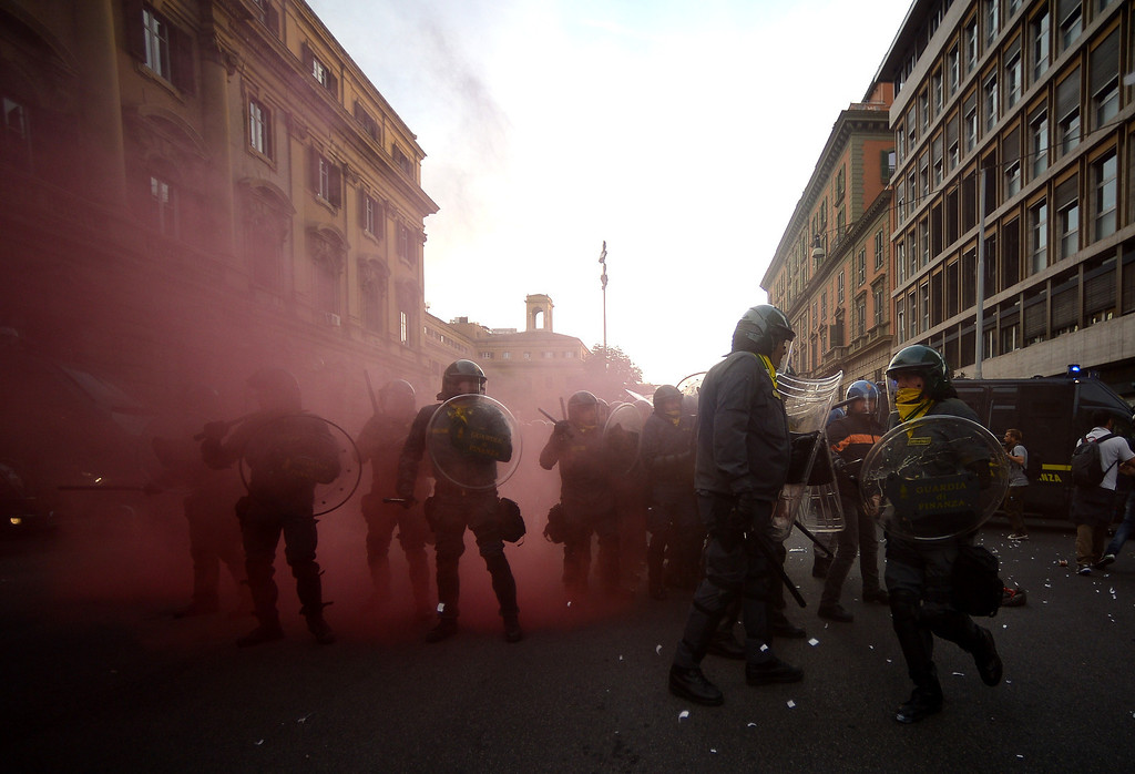 . Anti-riot policemen stand in a street during clashes on the sidelines of an anti-austerity protest on October 19, 2013 in Rome. Tens of thousands of people took to the streets in Italy and Portugal on Saturday to protest against budget cuts and the social cost of the economic crisis, amid concern over possible clashes in Rome. FILIPPO MONTEFORTE/AFP/Getty Images