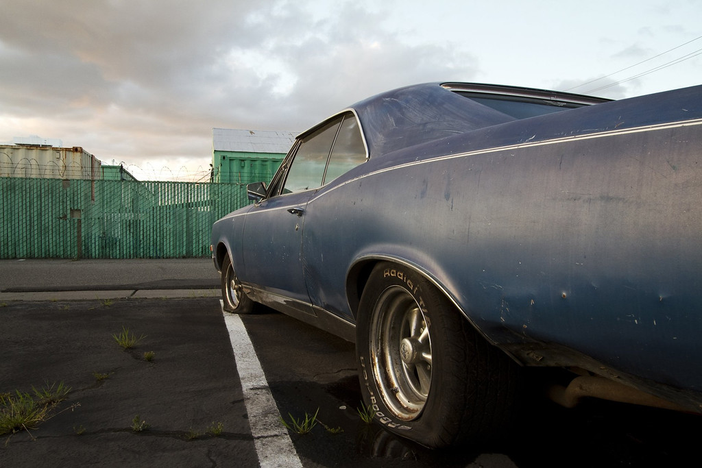 . An old Pontiac in a parking lot in San Jose, as captured by photographer Joshua Marcotte who has a passion for collecting images of objects from days gone by. A joint show with local artist Kori Thompson will open on Friday, Aug. 9, 2013, at San Jose\'s Empire Seven Studios.